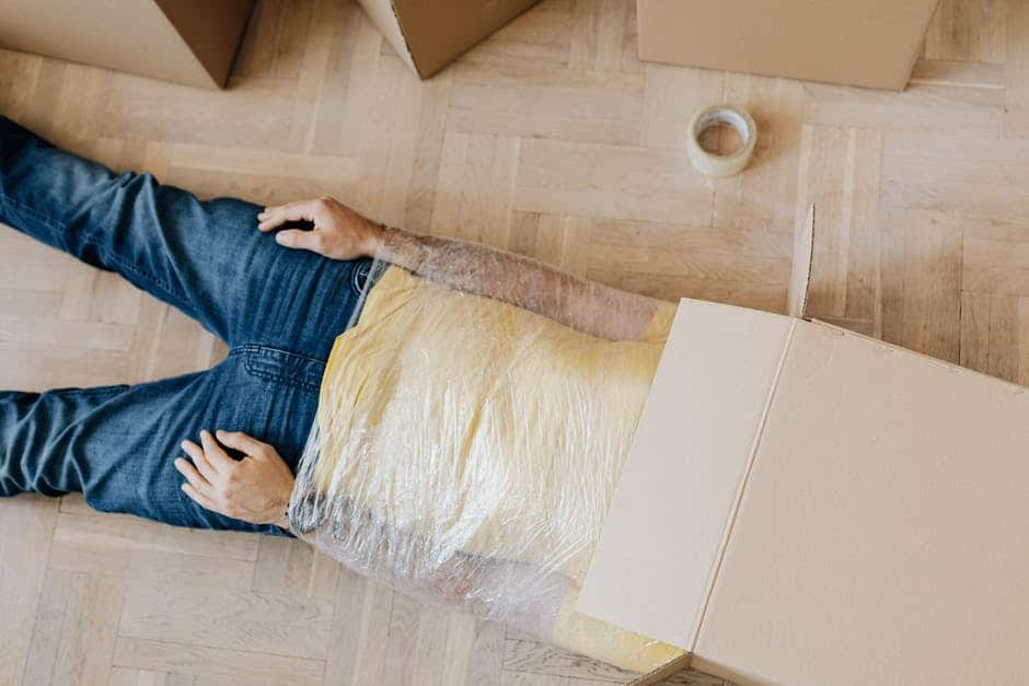 A person lying on a wooden floor